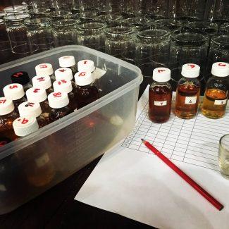 photo of rum testing bottles