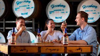 3 people tasting rum at table